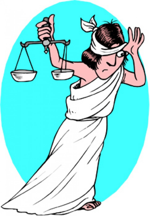Lady justice peaking from behind her blindfold