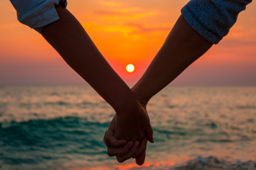 couple-holding-hands-sunset150685331pc | Arch Cape Inn